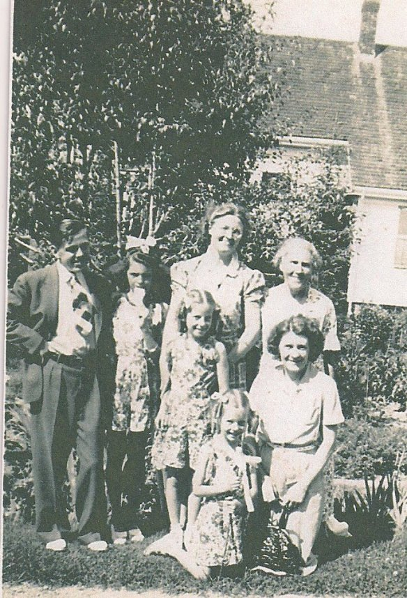 "Back Row: William ""Billy Boy"" Chambers, Helen ""Honey"" Frost, Mae Smith Chambers, Minnie Smith. Middle Row: Jane ""Ginger"" Frost, Helen Smith Frost. Front: Priscilla Frost. 1940 - 51 Hammond St, Bridgewater, MA"